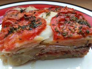 Tian de sardines.  <p>La sardine est en bonne compagnieavec les oignons, les tomates et les pommes de terre. Invitez la Provence à votre table !</p>